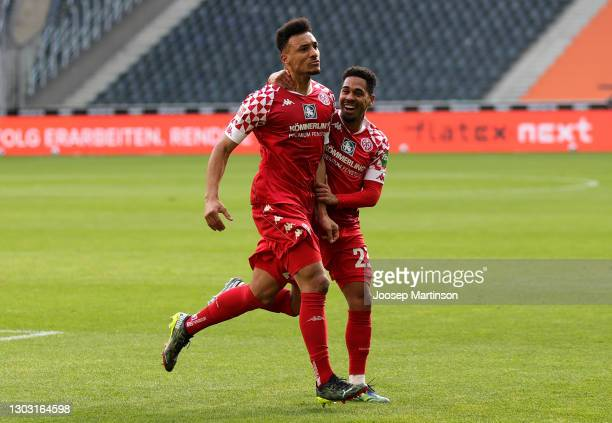 Karim Onisiwo of 1. FSV Mainz 05 celebrates with teammate Phillipp Mwene after scoring his team's first goal during the Bundesliga match between...