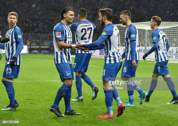 Karim Rekik and Mathew Leckie of Hertha BSC celebrate after scoring the 10 during the game between Hertha BSC and the Eintracht Frankfurt on december...