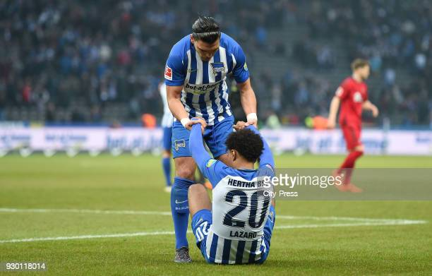 Karim Rekik and Valentino Lazaro of Hertha BSC after the Bundesliga match between Hertha BSC and SC Freiburg at Olympiastadion on March 10 2018 in...