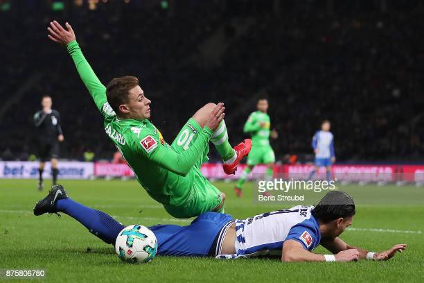 Karim Rekik of Berlin and Thorgan Hazard of Moenchengladbach fight for the ball during the Bundesliga match between Hertha BSC and Borussia...