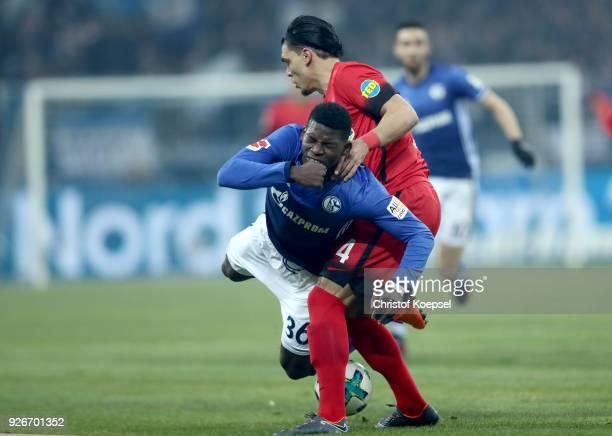 Karim Rekik of Berlin challenges Breel Embolo of Schalke during the Bundesliga match between FC Schalke 04 and Hertha BSC at VeltinsArena on March 3...