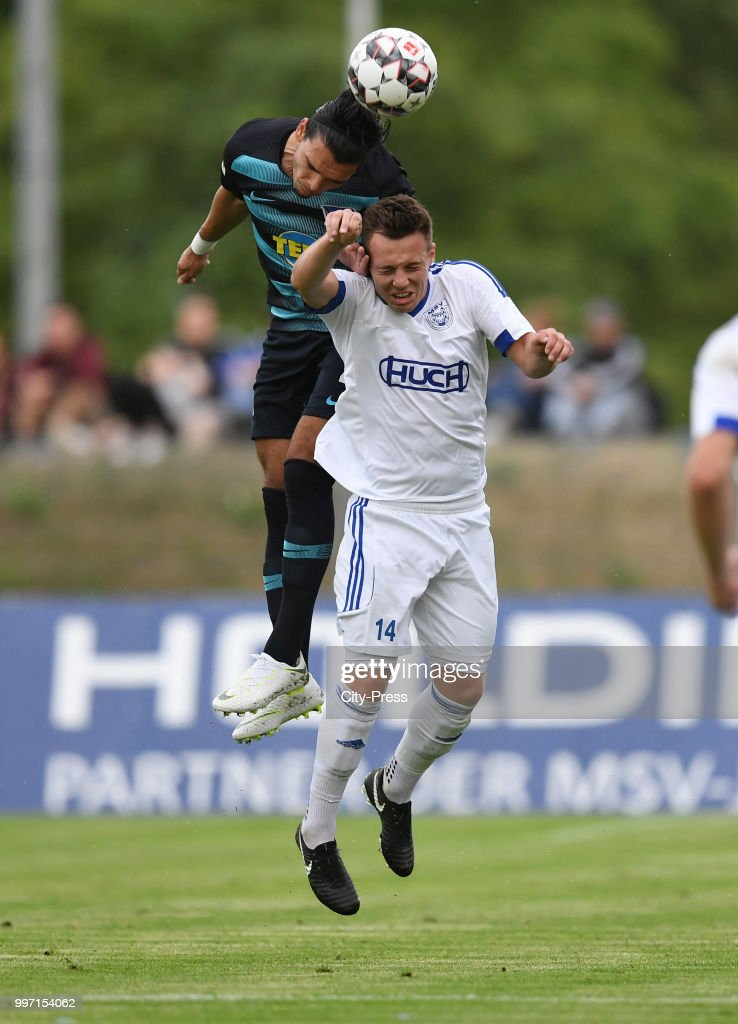 Karim Rekik of Hertha BSC and Florian Riehl of MSV Neuruppin during the game between MSV Neuruppin against Hertha BSC at the Volkspar-Stadion on july 12, 2018 in Neuruppin, Germany.