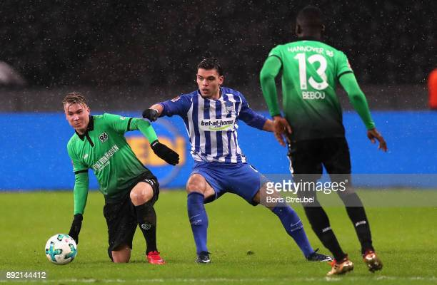 Karim Rekik of Hertha BSC battles for the ball with Felix Klaus of Hannover 96 during the Bundesliga match between Hertha BSC and Hannover 96 at...