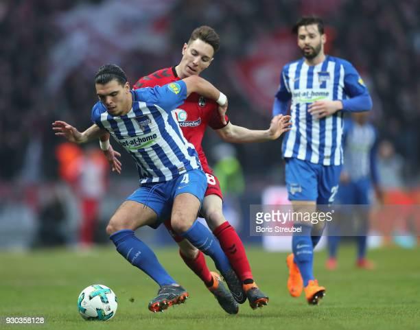 Karim Rekik of Hertha BSC battles for the ball with Florian Kath of SC Freiburg during the Bundesliga match between Hertha BSC and SportClub Freiburg...