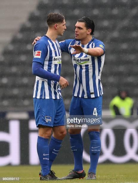 Karim Rekik of Hertha BSC gestures with Niklas Stark of Hertha BSC during the Bundesliga match between Hertha BSC and SportClub Freiburg at...