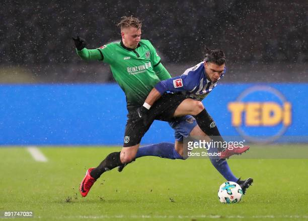 Karim Rekik of Hertha BSC is challenged by Felix Klaus of Hannover 96 during the Bundesliga match between Hertha BSC and Hannover 96 at...