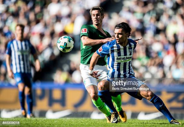 Karim Rekik of Hertha BSC is challenged by Fin Bartels of SV Werder Bremen during the Bundesliga match between Hertha BSC and SV Werder Bremen at...
