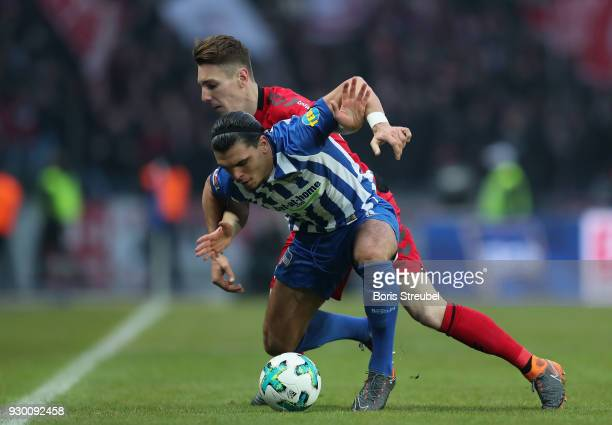Karim Rekik of Hertha BSC is challenged by Florian Kath of SC Freiburg during the Bundesliga match between Hertha BSC and SportClub Freiburg at...
