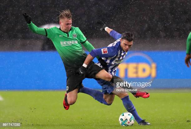 Karim Rekik of Hertha BSC is tackled by Felix Klaus of Hannover 96 during the Bundesliga match between Hertha BSC and Hannover 96 at Olympiastadion...