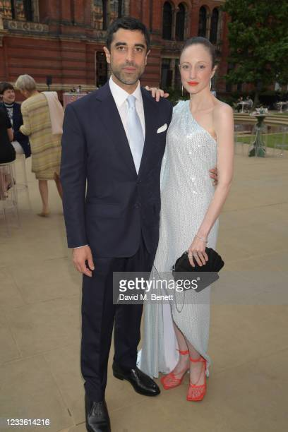 """Karim Saleh and Andrea Riseborough attend a private view of """"Alice: Curiouser and Curiouser"""" at The V&A on June 23, 2021 in London, England."""