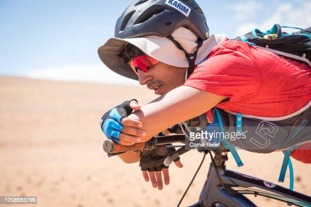 Karim Zeroual rests on his bike on Day 1 of the Sport Relief challenge The Heat is On as the team sets off on February 24 2020 in the Namib Desert...
