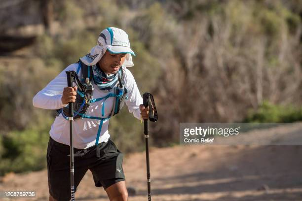 Karim Zeroual walks across the sand on Day 2 of the Sport Relief challenge The Heat is On as the team sets off on February 25 2020 in the Namib...