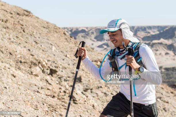 Karim Zeroual walks on Day 2 of the Sport Relief challenge The Heat is On as the team sets off on February 25 2020 in the Namib Desert Namibia They...