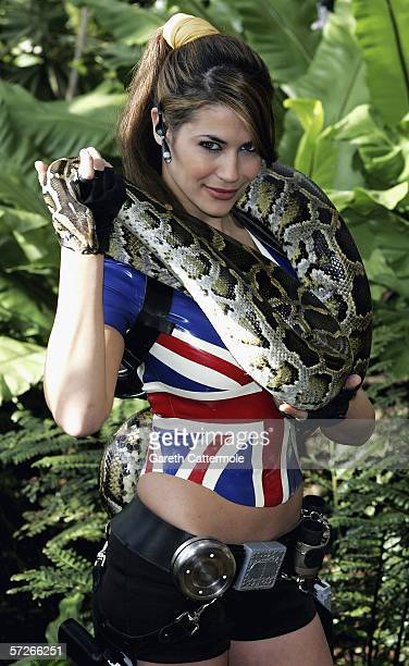 Karima Adebibe the newly crowned face of Lara Croft poses with a Burmese python on the eve of the release of the record breaking new video game Lara...
