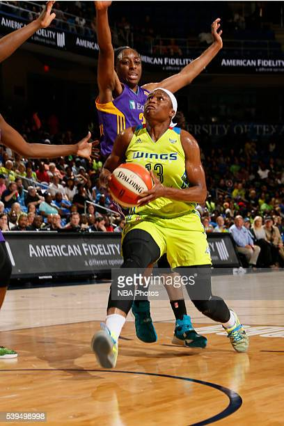 Karima Christmas of the Dallas Wings drives to the basket against the Los Angeles Sparks on June 11 2016 at College Park Center in Arlington Texas...
