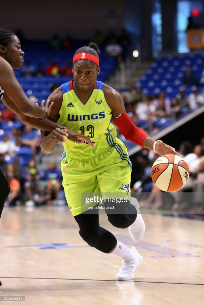 Karima Christmas of the Dallas Wings goes to the basket against the ...