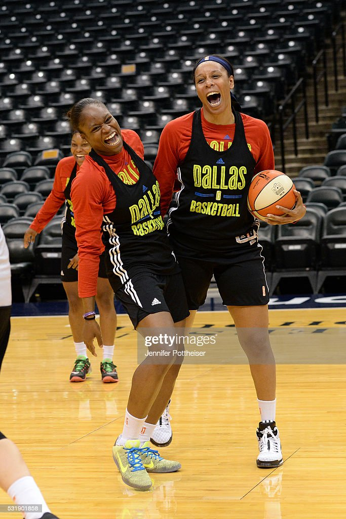 Karima Christmas #13 of the Dallas Wings shares a laugh with Plenette Pierson during practice before the game against the Indiana Fever on May 14, 2016 in Indianapolis, Indiana.