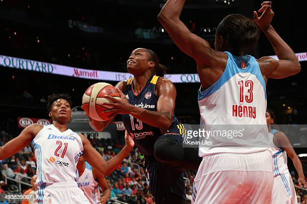 Karima Christmas of the Indiana Fever shoots between Amanda Thompson of the Atlanta Dream and Aneika Henry of the Atlanta Dream during the 3rd...