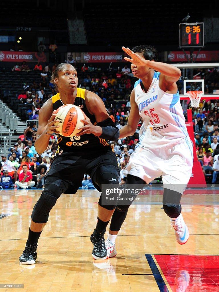Karima Christmas of the Tulsa Shock handles the ball against the ...