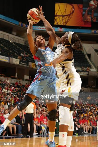 Karima Christmas the Indiana Fever battles Angel McCoughtry of the Atlanta Dream in game two of the WNBA Eastern Conference Finals on September 29...