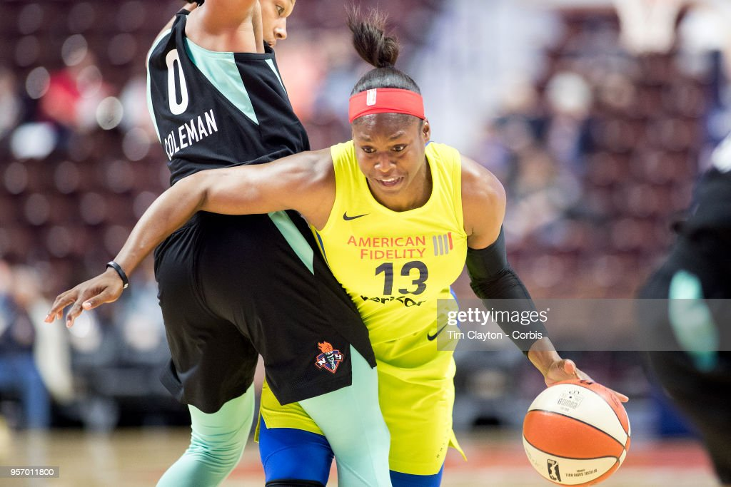 Karima Christmas-Kelly of the Dallas Wings defended by Marissa ...