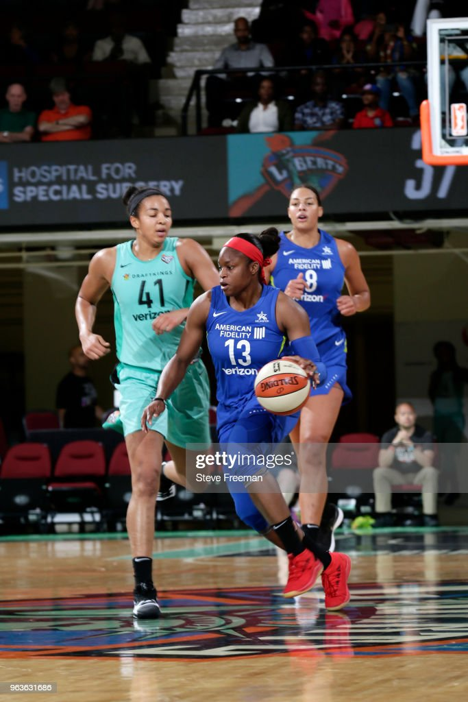 Karima Christmas-Kelly of the Dallas Wings handles the ball against ...