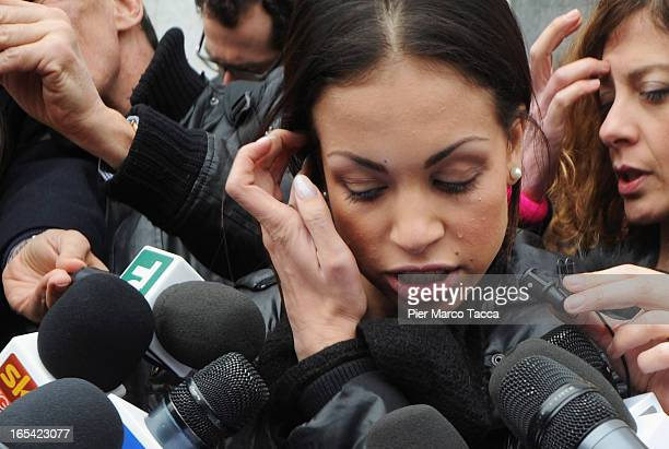 Karima El Mahroug cries as she reads a statement to members of the media during a protest in front of Palazzo di Giustizia on April 4 2013 in Milan...