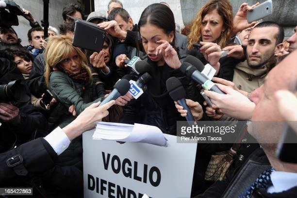 Karima El Mahroug speaks to members of the media during a protest in front of Palazzo di Giustizia on April 4 2013 in Milan Italy Karima El Mahroug...