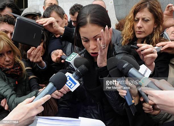Karima El Mahroug speaks to memners of the media during a protest in front of Palazzo di Giustizia on April 4 2013 in Milan Italy Karima El Mahroug...