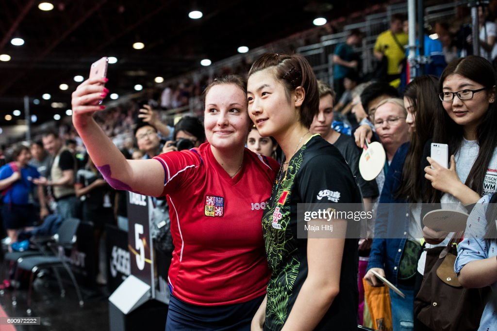 Karin Adamkova of Czech Republic makes a selfie with Ding Ning of China after loosing against her during Women Single 2. Round at Table Tennis World Championship at Messe Duesseldorf on May 31, 2017 in Dusseldorf, Germany.