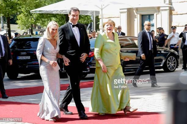 Karin Baumueller and her husband German politician Markus Soeder and German Federal Chancellor Angela Merkel, during the Bayreuth Festival 2019...