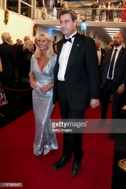 Karin Baumueller and her husband German politician Markus Soeder attend the Bayreuth Festival 2019 State Reception at Neues Schloss on July 25 2019...
