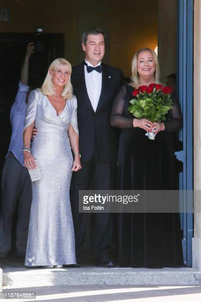 Karin Baumueller with her husband German politician Markus Soeder and Katharina Wagner during the Bayreuth Festival 2019 opening premiere Tannhaeuser...