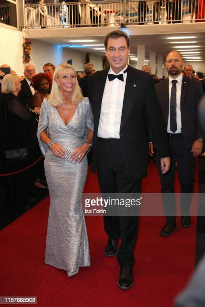 Karin Baumueller with her husband German politician Markus Soeder attends the Bayreuth Festival 2019 State Reception at Neues Schloss on July 25 2019...