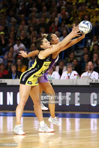 Karin Burger of the Pulse and Mila ReueluBuchanan of the Stars compete for the ball during the ANZ Premiership Netball Final between the Pulse and...