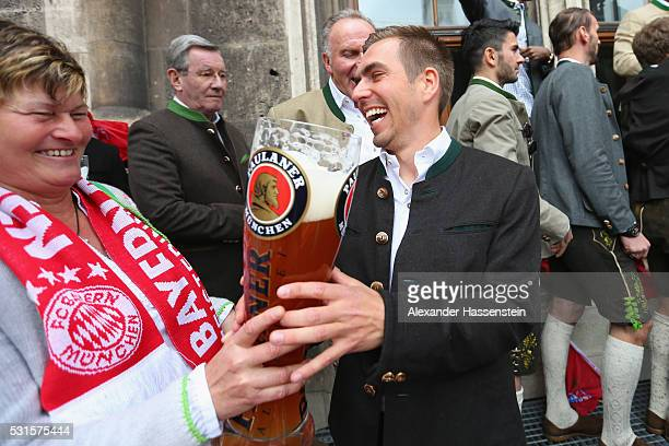 Karin Danner team manager of Bayern Muenchen women`s team and Philipp Lahm of Bayern Muenchen celebrates winning the German Championship title on the...