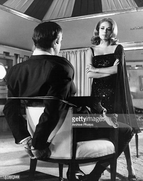 Karin Dor is looking at Sean Connery as he is tied up in a chair in a scene from the film 'You Only Live Twice' 1967