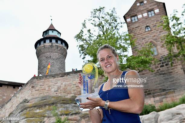 Karin Knapp of Italy poses in front of Nuremberg Castle after her victory in the Nuernberger Versicherungscup 2015 on May 23 2015 in Nuremberg Germany