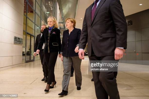 Karin Maag the chair of the parliamentary CDU/CSU women's group arrives with the German chancellor Angela Merkel at a networking meeting for members...