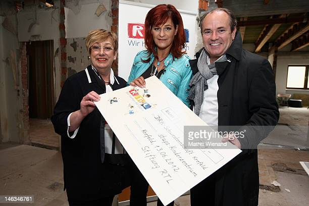 Karin Meincke Andrea Berg and Wolfram Kons visit the Stups Children Center for the RTL Charity Marathon on June 13 2012 in Krefeld Germany