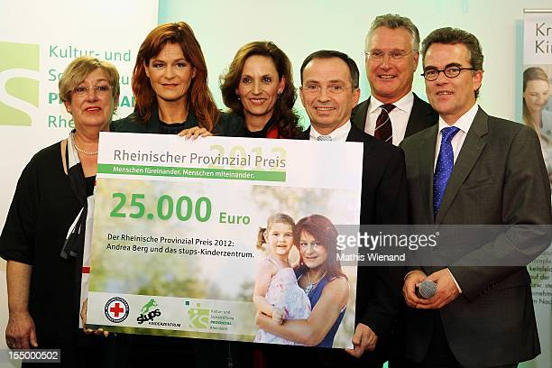 Karin Meincke Andrea Berg Ulrike Lubek Ludger Goossen Rudolf Gaul and Gregor Kathdtede attend the Stups Childrens Center Opening on October 30 2012...