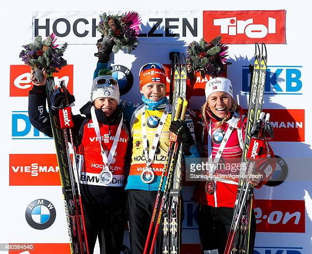 Karin Oberhofer of Italy takes 2nd place, Kaisa Makarainen of Finland takes 1st place,Tiril Eckhoff of Norway takes 3rd place during the IBU Biathlon...