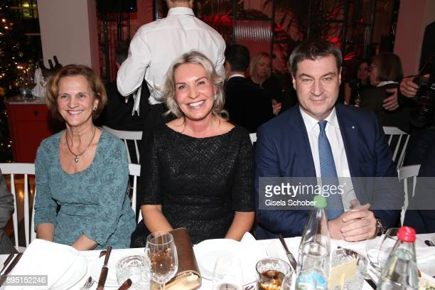 Karin Seehofer, Saskia Greipl and Markus Soeder during the annual Christmas Roast Kid Dinner on December 18, 2017 in Munich, Germany.