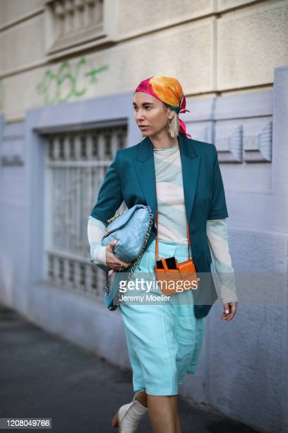 Karin Teigl is seen wearing a Fendi and Chanel bag HM hair band and a blue short during Milan Fashion Week Fall/Winter 20202021 on February 22 2020...