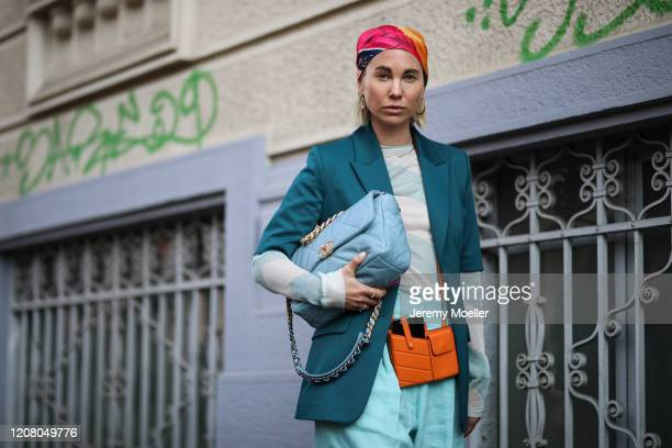Karin Teigl is seen wearing a Fendi and Chanel bag, H&M hair band and a blue short during Milan Fashion Week Fall/Winter 2020-2021 on February 22,...