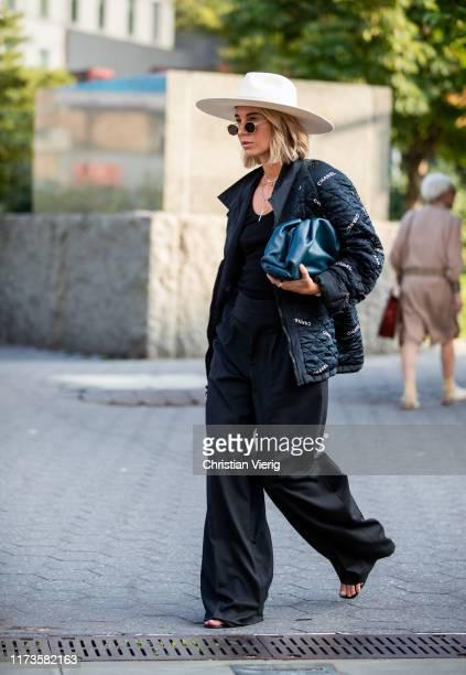 Karin Teigl is seen wearing Balenciaga jacket, hat, black pants, bag outside Anna Sui during New York Fashion Week September 2019 on September 09,...