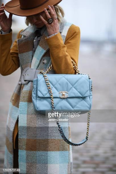 Karin Teigl wearing a Chanel bag and Gestuz coat before Mykke Hofmann on January 28, 2020 in Copenhagen, Denmark.