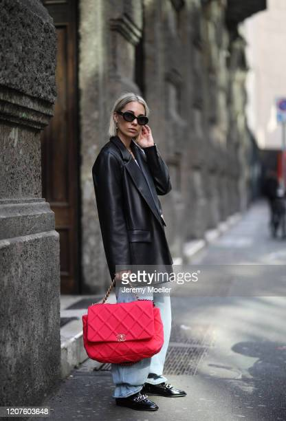 Karin Teigl wearing a Chanel bag and shades and Zara loafer during Milan Fashion Week Fall/Winter 2020-2021 on February 19, 2020 in Milan, Italy.