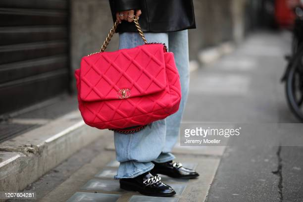 Karin Teigl wearing a Chanel bag and shades and Zara loafer during Milan Fashion Week Fall/Winter 20202021 on February 19 2020 in Milan Italy