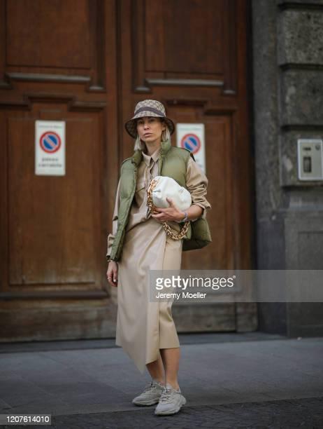 Karin Teigl wearing a Gucci bucket hat, Adidas Ozweego, a vest and Bottega Veneta pouch bag during Milan Fashion Week Fall/Winter 2020-2021 on...